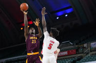 FILE - In this file photo dated Saturday, March 13, 2021, Iona's Nelly Junior Joseph, left, goes up for a shot against Fairfield's Supreme Cook in the first half of an NCAA college basketball game during the finals of the Metro Atlantic Athletic Conference tournament, in Atlantic City, USA. The NBA's global academy system is beginning to produce high-level collegiate players, as the upcoming NCAA Tournament will include eight NBA Academy alumni. (AP Photo/Matt Slocum, FILE)