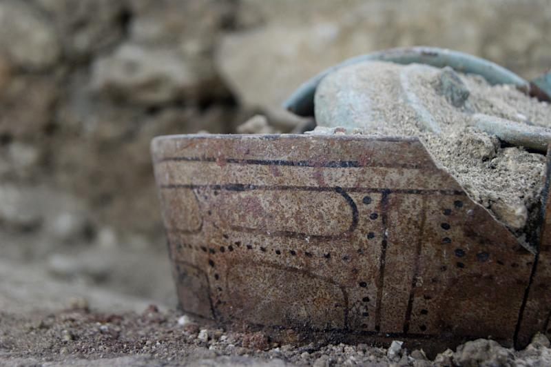In this June 17, 2012 photo released by the El Peru-Waka Archaeological Project shows a ceramic pot found in a burial chamber at the El Peru-Waka archaeological site in Laguna del Tigre National Park in Peten, north of Guatemala City.  Archaeologists say a stone jar found at burial chamber in northern Guatemala leads them to believe it is the tomb of a great Maya queen. The team of U.S. and Guatemalan experts led by anthropologist David Freidel has also found other evidence, such as ceramic vessels and a large stone with carvings referring it as the burial site of Lady K'abel, considered the military governor of an ancient Maya city during the seventh century.  (AP Photo/El Peru-Waka' Archaeological Project)