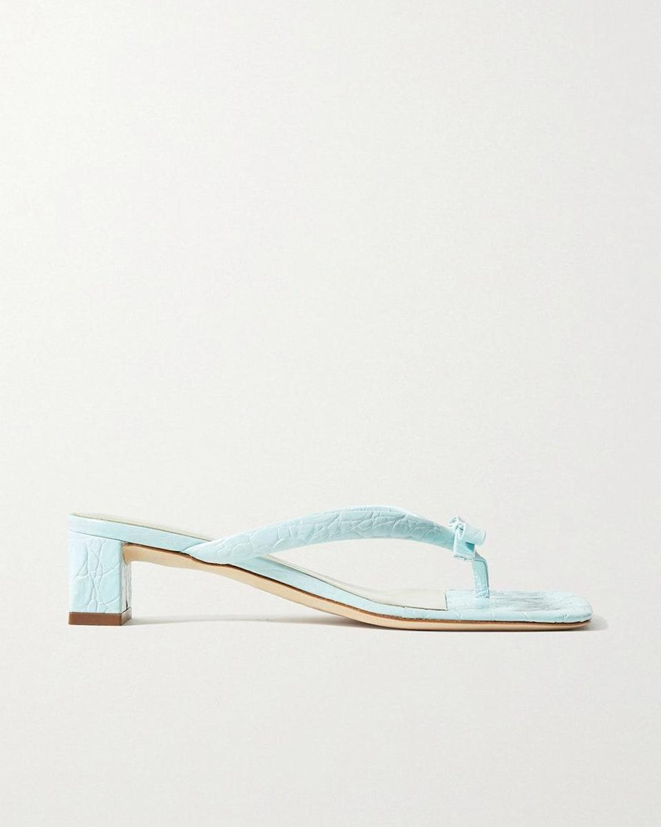 """""""I've been in search of a summer heel that adds color and is light enough to run around the city in— and this is just the sandal. At an affordable price, I can finally snag a pair."""" - <em>JN</em> $410, Net-a-Porter. <a href=""""https://www.net-a-porter.com/en-us/shop/product/by-far/shoes/mid-heel/bibi-bow-embellished-croc-effect-leather-sandals/2204324138659570"""" rel=""""nofollow noopener"""" target=""""_blank"""" data-ylk=""""slk:Get it now!"""" class=""""link rapid-noclick-resp"""">Get it now!</a>"""