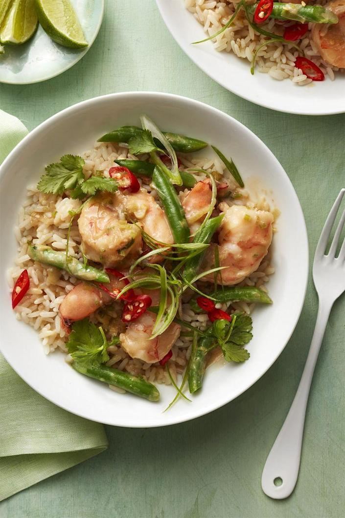 "<p> Take a temporary trip to the islands with spicy coconut shrimp dish. Pro tip: to make sure your rice doesn't get clumpy when cooking, rinse the grains under cold water before cooking.</p><p><a href=""https://www.womansday.com/food-recipes/food-drinks/recipes/a58518/coconut-shrimp-rice-recipe/"" rel=""nofollow noopener"" target=""_blank"" data-ylk=""slk:Get the Coconut Shrimp and Rice recipe."" class=""link rapid-noclick-resp""><em>Get the Coconut Shrimp and Rice recipe.</em></a></p>"