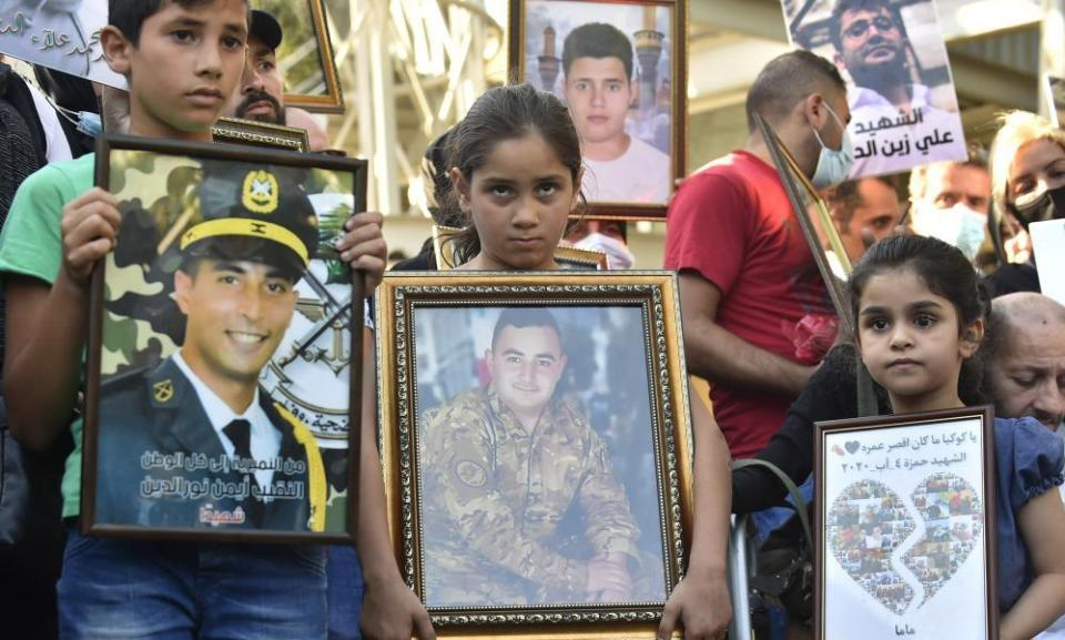 Relatives of those who died in the Beirut explosion stage a protest that those responsible have not been brought to justice almost a year on.