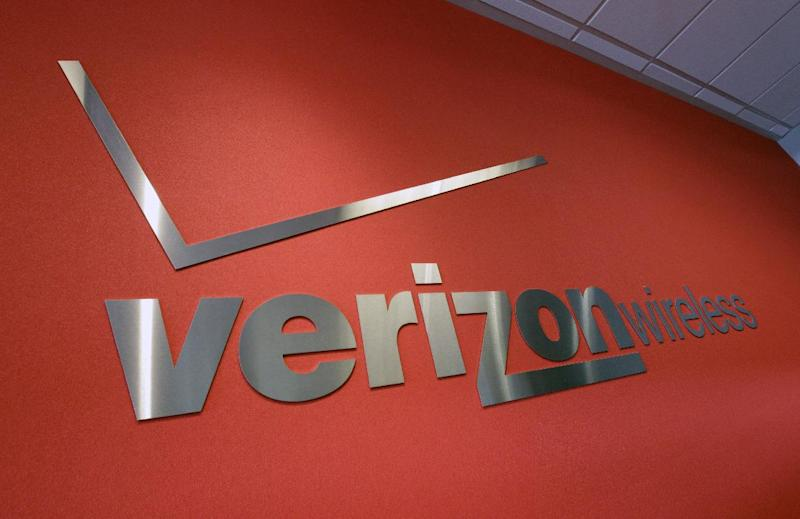 FILE- In this Tuesday, June 12, 2012, file photo, the Verizon logo is seen at Verizon store in Mountain View, Calif. Verizon Communications Inc., parent of the country's largest cellphone carrier, on Thursday, July 19, 2012, said its net income rose 13 percent in the second quarter as its wireless arm pulled in record profits. (AP Photo/Paul Sakuma, File)