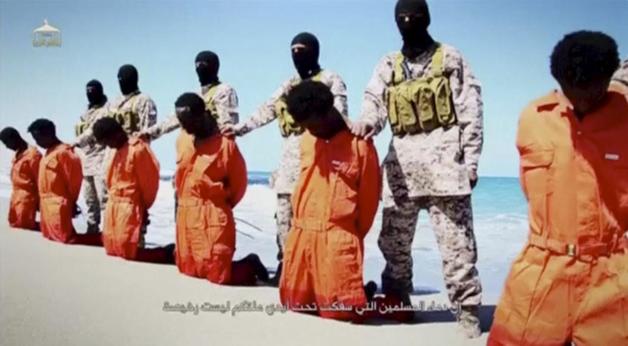 Islamic State militants stand behind what are said to be Ethiopian Christians along a beach in Wilayat Barqa, in this still image from an undated video made available on a social media website on April 19, 2015. The video purportedly made by Islamic State and posted on social media sites on Sunday appeared to show militants shooting and beheading about 30 Ethiopian Christians in Libya. Reuters was not able to verify the authenticity of the video but the killings resemble past violence carried out by Islamic State, an ultra-hardline group which has expanded its reach from strongholds in Iraq and Syria to conflict-ridden Libya. Libyan officials were not immediately available for comment. Ethiopia said it had not been able to verify whether the people shown in the video were its citizens. REUTERS/Social Media Website via Reuters TVATTENTION EDITORS - THIS PICTURE WAS PROVIDED BY A THIRD PARTY VIDEO. REUTERS IS UNABLE TO INDEPENDENTLY VERIFY THE AUTHENTICITY, CONTENT, LOCATION OR DATE OF THIS IMAGE. THIS PICTURE IS DISTRIBUTED EXACTLY AS RECEIVED BY REUTERS, AS A SERVICE TO CLIENTS.