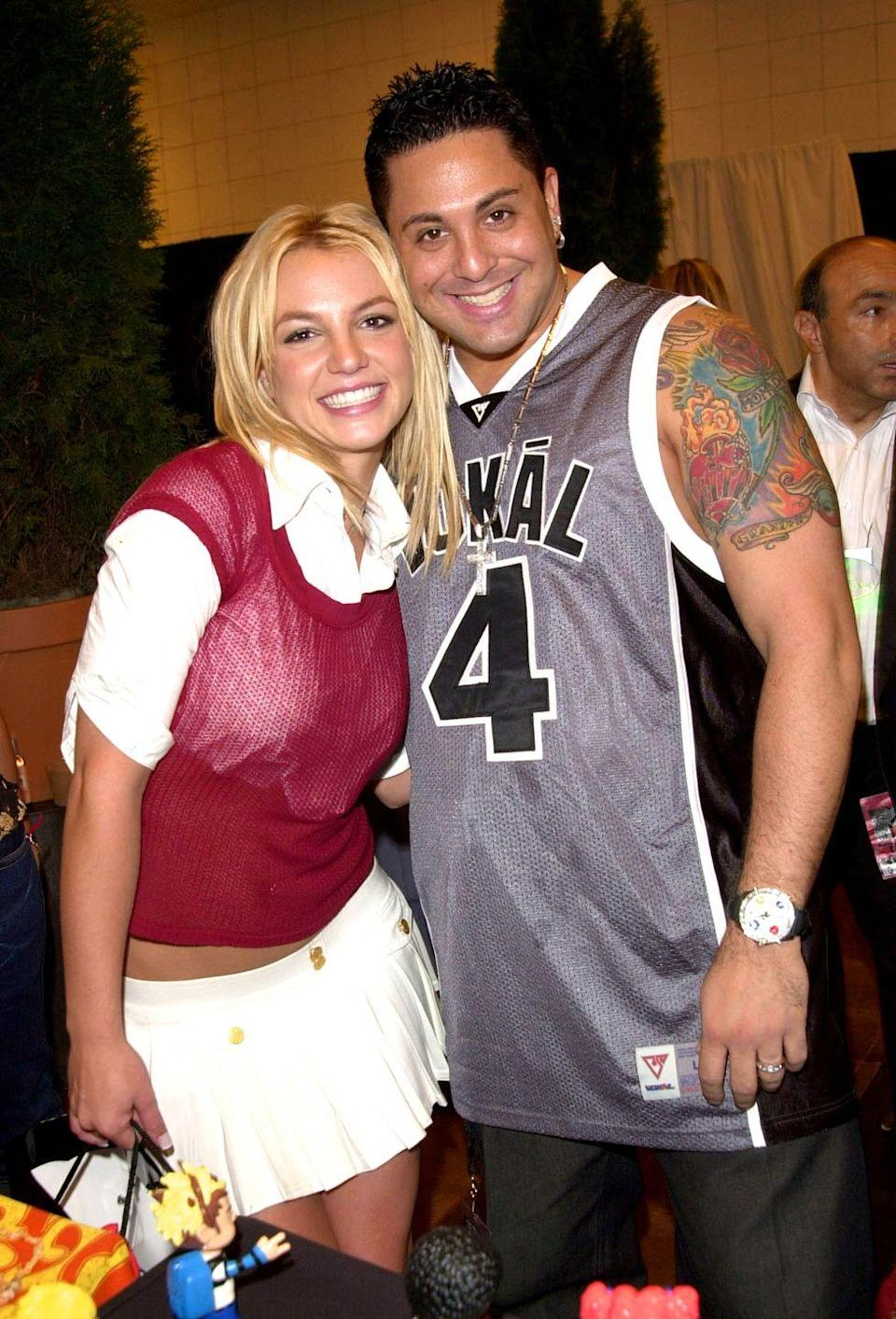 <p>Throwback to when wearing a short-sleeve sweater over a white button-down was the ultimate outfit. Here, Brit completed it with a pleated tennis skirt because why not?</p>