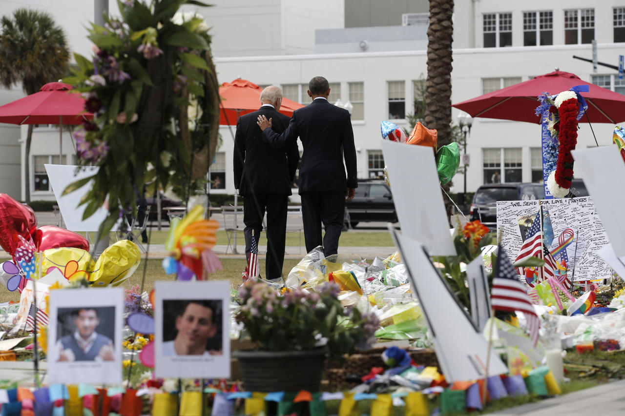 <p>President Obama and Vice President Biden depart a makeshift memorial after placing flowers in memory of shooting victims in Orlando, Fla., June 16, 2016. (Carlos Barria/Reuters) </p>