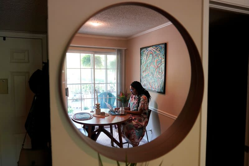 Jaleesa Garland, a marketing manager at an e-commerce startup, works in her apartment in Tulsa