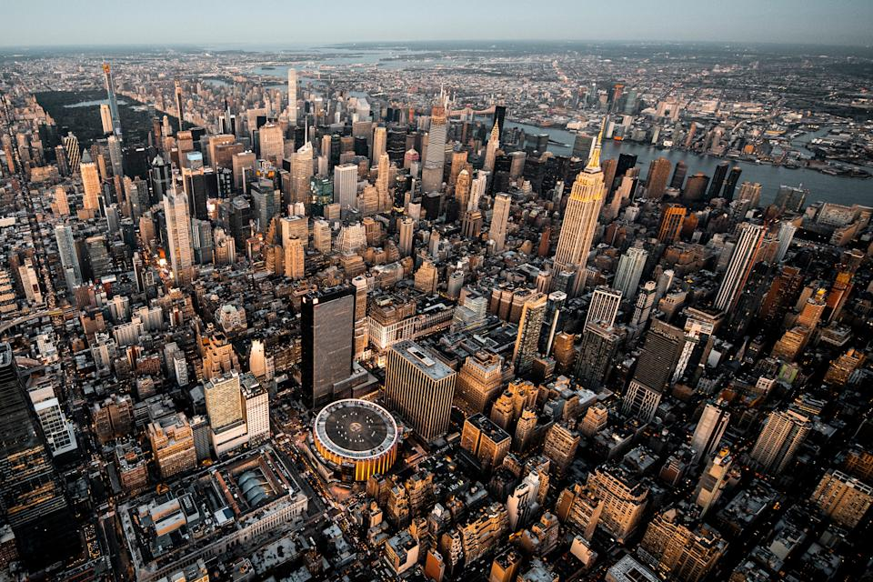 High angle view of a Manhattan metropolitan area, taken at sunset from a helicopter.