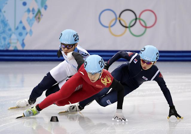 Han Tianyu of China, centre, Park Se-Yeong of South Korea, right, and Victor An of Russia, left, compete in a men's 1500m short track speedskating semifinal at the Iceberg Skating Palace during the 2014 Winter Olympics, Monday, Feb. 10, 2014, in Sochi, Russia. (AP Photo/Bernat Armangue)