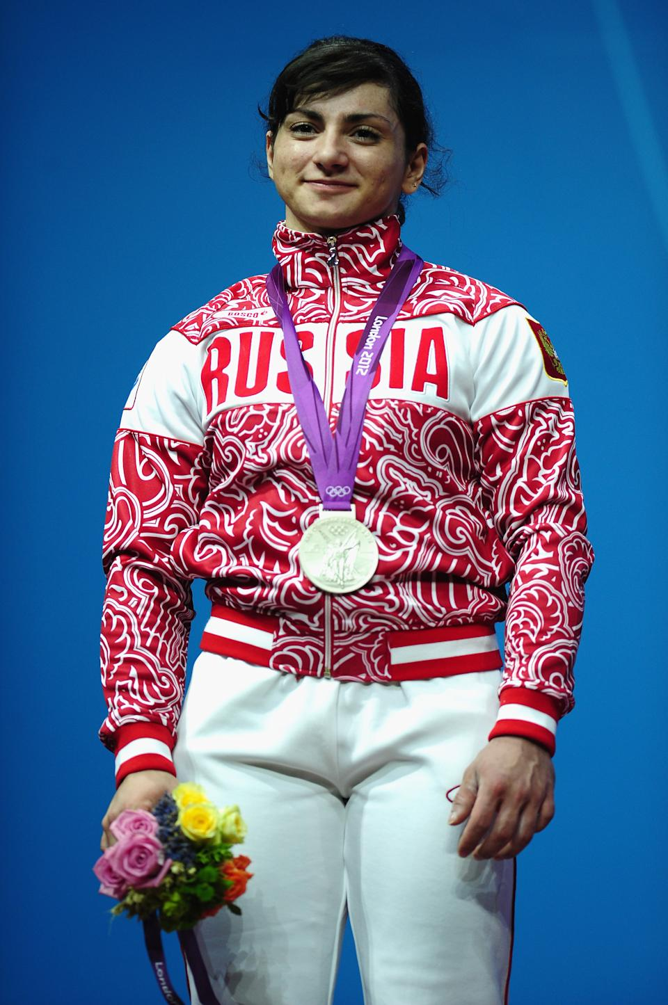 LONDON, ENGLAND - JULY 31: Svetlana Tsarukaeva of Russia stands on the podium with her silver medal after the Women's 63kg Weightlifting final on Day 4 of the London 2012 Olympic Games at ExCeL on July 31, 2012 in London, England. (Photo by Laurence Griffiths/Getty Images)