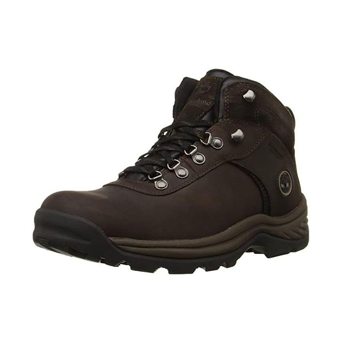 """<p><strong>Timberland</strong></p><p>amazon.com</p><p><strong>$99.99</strong></p><p><a href=""""https://www.amazon.com/dp/B001EWFF5S?tag=syn-yahoo-20&ascsubtag=%5Bartid%7C2139.g.37095236%5Bsrc%7Cyahoo-us"""" rel=""""nofollow noopener"""" target=""""_blank"""" data-ylk=""""slk:BUY IT HERE"""" class=""""link rapid-noclick-resp"""">BUY IT HERE</a></p><p>Timberland's hiking boots feature full-grain waterproof leather that's both stylish and protective. The shoes also have multidirectional lugs for traction while climbing and traversing rocky ground, plus a fully gusseted tongue to keep out debris. These should withstand any <a href=""""https://www.menshealth.com/technology-gear/g29503936/hiking-essentials/"""" rel=""""nofollow noopener"""" target=""""_blank"""" data-ylk=""""slk:hiking trip"""" class=""""link rapid-noclick-resp"""">hiking trip</a>, even if there's a stream or a bit of rain.</p>"""