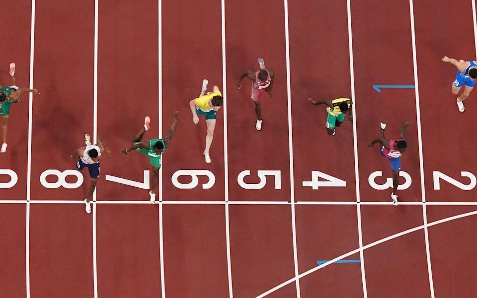 Zharnel Hughes of Britain crosses the line to win the race - Reuters
