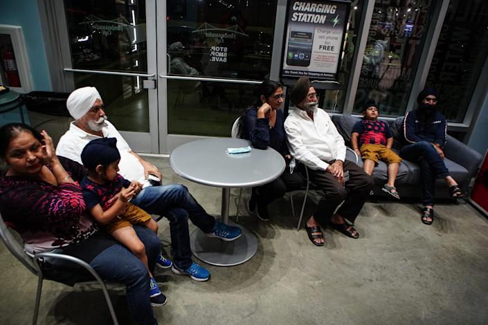 The Singh and Kaur family stop at the Ambassador Duty Free store, waiting for the clock to hit midnight in Detroit on Sunday, August 8, 2021. Canada reopened its borders to the United States on Monday, allowing for fully vaccinated U.S. citizens and permanent residents to cross the border.