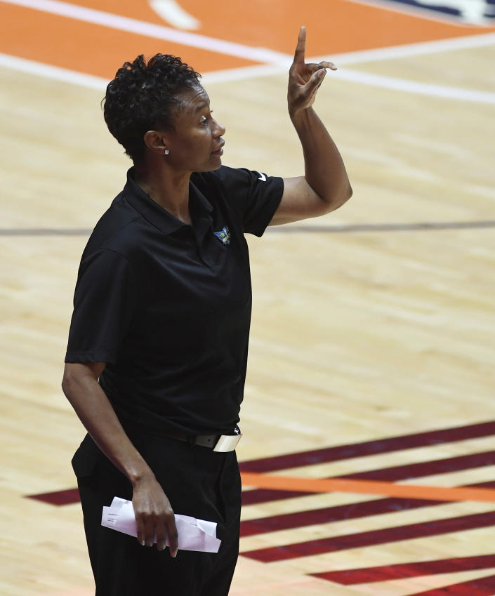 Dallas Wings head coach Vicky Johnson calls out instructios to her team as they play the Connecticut Sun during a WNBA basketball game Tuesday, June 22, 2021 at Mohegan Sun Arena in Uncasville, Conn. (Sean D. Elliot/The Day via AP)
