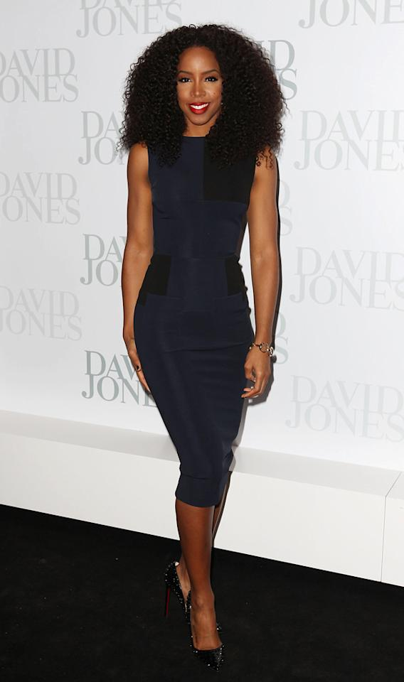 "<p class=""MsoNormal"">Beyonce's former fellow Destiny's Child member Kelly Rowland, who is currently serving as a mentor on the Australian dance show ""Everybody Dance Now,"" turned heads at the David Jones spring fashion launch party in Sydney thanks to her form-fitting Victoria Beckham sheath. A big curly 'do, red-hot lips, and Christian Louboutin ""Pigalle Spikes"" made for the perfect finishing touches. (8/14/2012) </p>"