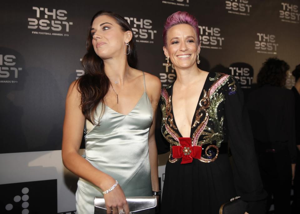United States forward Megan Rapinoe, right, arrives with Alex Morgan to attend the Best FIFA soccer awards, in Milan's La Scala theater, northern Italy, Monday, Sept. 23, 2019. Netherlands defender Virgil van Dijk is up against five-time winners Cristiano Ronaldo and Lionel Messi for the FIFA best player award and Rapinoe is the favorite for the women's award. (AP Photo/Luca Bruno)