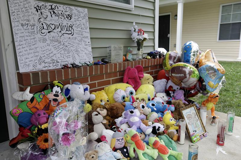 A makeshift memorial for the slain Dominick Andujar sets on his front porch, Tuesday, Sept. 4, 2012, in Camden, N.J. Authorities say 31-year-old Osvaldo Rivera killed 6-year-old Andujar and critically injured his 12-year-old sister in Camden early Sunday. (AP Photo/Matt Rourke)