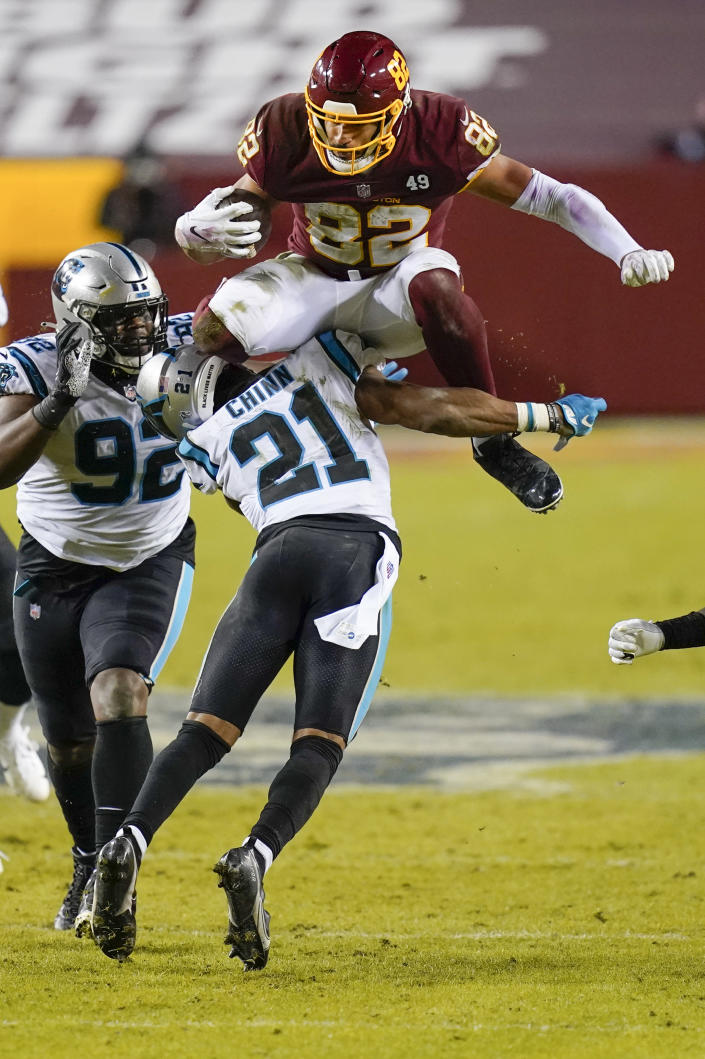 Washington Football Team tight end Logan Thomas (82) leaps over Carolina Panthers outside linebacker Jeremy Chinn (21) for a first down during the second half of an NFL football game Sunday, Dec. 27, 2020, in Landover, Md. Carolina won 20-13. (AP Photo/Carolyn Kaster)