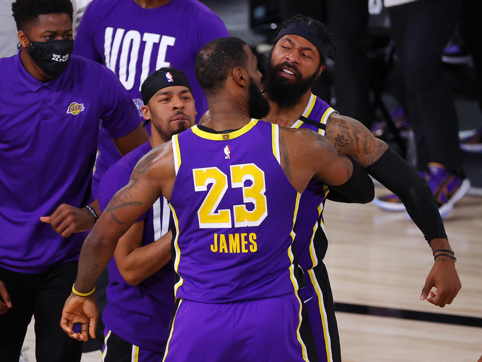 LAKE BUENA VISTA, FLORIDA - SEPTEMBER 26: LeBron James #23 of the Los Angeles Lakers celebrates with teammates during the fourth quarter against the Denver Nuggets in Game Five of the Western Conference Finals during the 2020 NBA Playoffs at AdventHealth Arena at the ESPN Wide World Of Sports Complex on September 26, 2020 in Lake Buena Vista, Florida. NOTE TO USER: User expressly acknowledges and agrees that, by downloading and or using this photograph, User is consenting to the terms and conditions of the Getty Images License Agreement. (Photo by Kevin C. Cox/Getty Images)