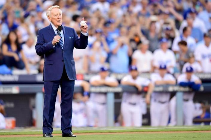 """Former Dodgers broadcaster Vin Scully speaks during a pregame ceremony at Dodger Stadium. <span class=""""copyright"""">(Harry How / Getty Images)</span>"""
