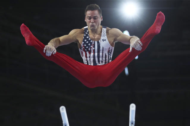 Samuel Mikulak of the United States performs on the parallel bars in the men's team final at the Gymnastics World Championships in Stuttgart, Germany, Wednesday, Oct. 9, 2019. (AP Photo/Matthias Schrader)