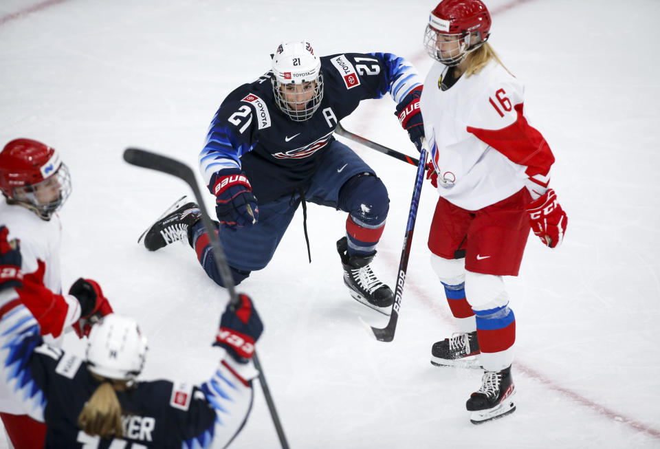 Hilary Knight, left, of the United States, celebrates her goal as Russia's Ilona Markova looks on during second period IIHF Women's World Championship hockey action in Calgary, Alberta, Tuesday, Aug. 24, 2021. (Jeff McIntosh/The Canadian Press via AP)
