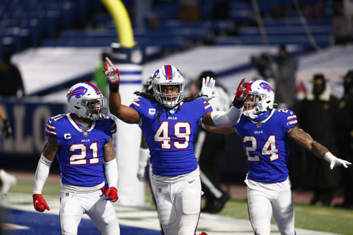 Buffalo Bills middle linebacker Tremaine Edmunds (49) celebrates with Jordan Poyer (21) and Taron Johnson (24) during the second half of an NFL divisional round football game Saturday, Jan. 16, 2021, in Orchard Park, N.Y. The Bills won 17-3. (AP Photo/John Munson)