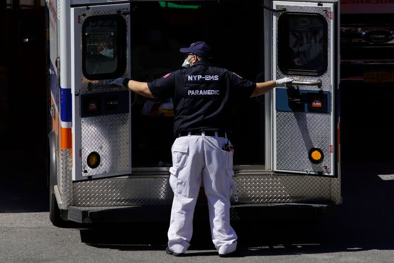 A paramedic closes doors to an ambulance outside Elmhurst Hospital during outbreak of coronavirus disease (COVID-19) in New York