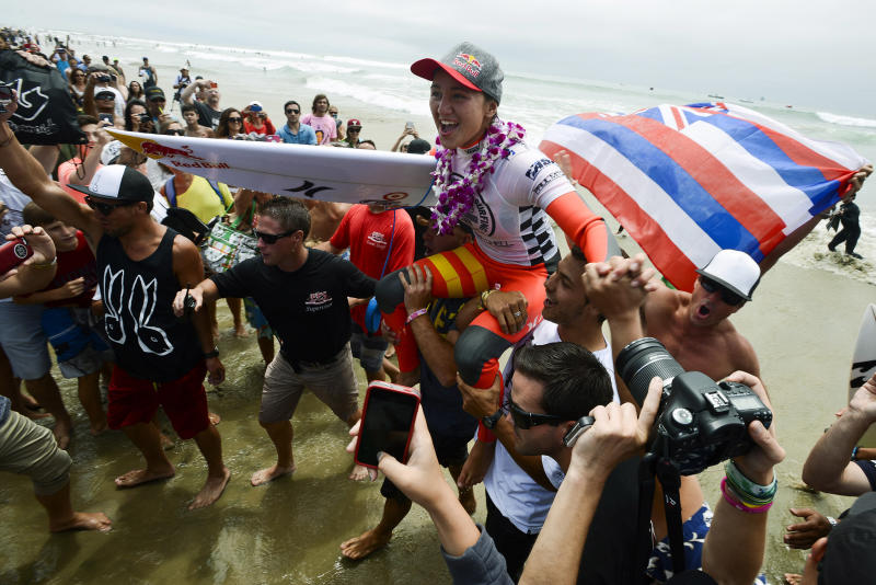 Carissa Moore, of Hawaii, is lifted out of the water after defeating local surfer Courtney Conlogue on Sunday, July 28, 2013, during a close women's final at the Vans US Open of Surfing in Huntington Beach, Calif. Moore has won two US Open championships, with her first win in 2010. (AP Photo/The Orange County Register, Kevin Lara) MAGS OUT; LOS ANGELES TIMES OUT.