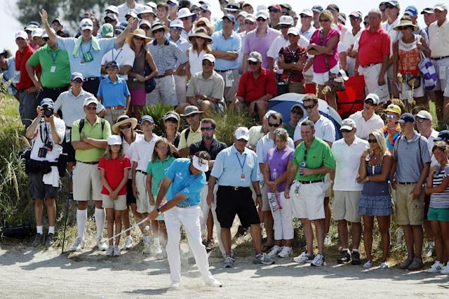 Phil Mickelson hits from the sand along the seventh hole during the first round of the PGA Championship golf tournament on the Ocean Course of the Kiawah Island Golf Resort in Kiawah Island, S.C., Thursday, Aug. 9, 2012. (AP Photo/Lynne Sladky)