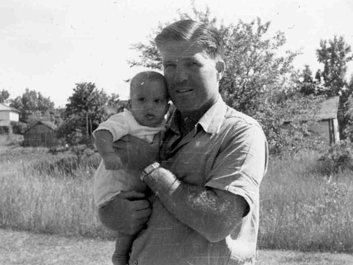 Mitt Romney in a family archive photo with his father in 1947.