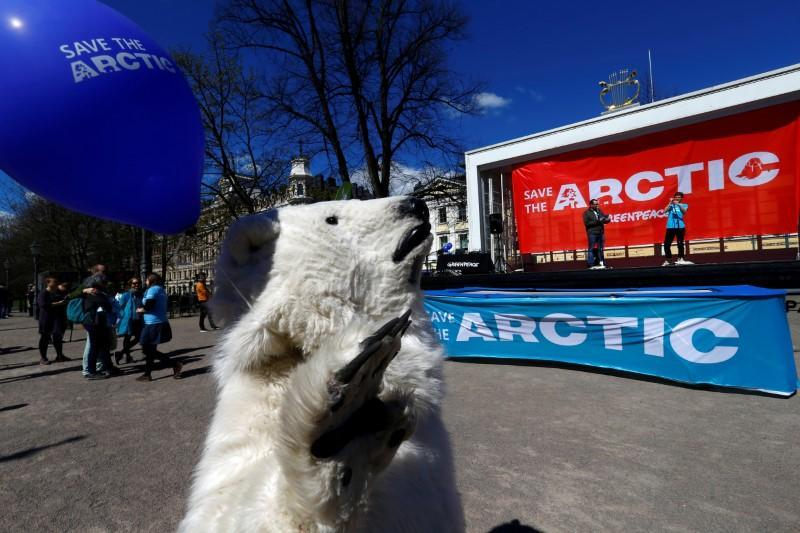 FILE PHOTO: Greenpeace activists campaign for the Arctic in Helsinki