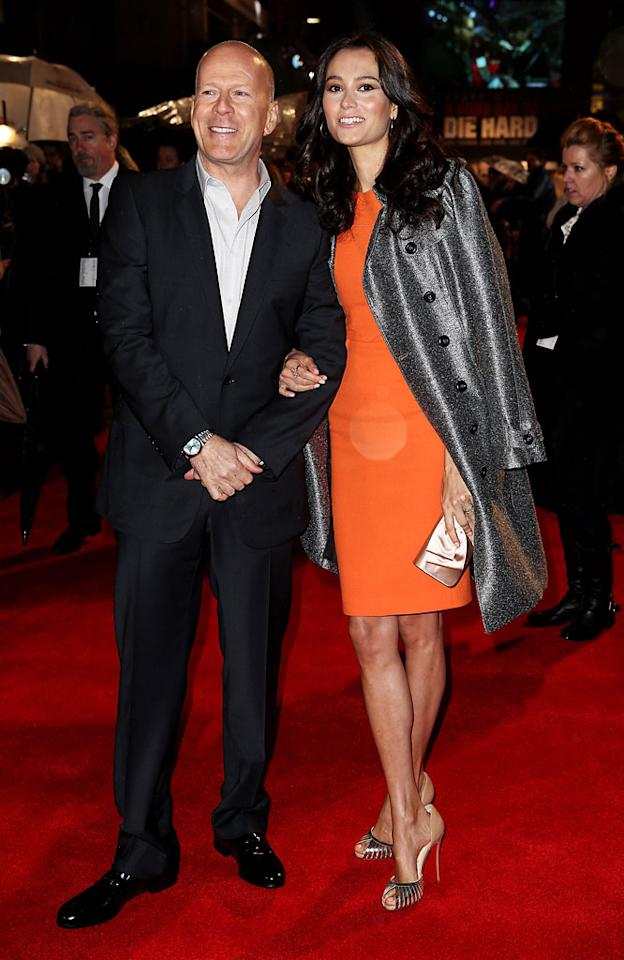 Bruce Willis (L) and wife Emma Heming attend the UK Premiere of 'A Good Day To Die Hard' at Empire Leicester Square on February 7, 2013 in London, England.  (Photo by Dave M. Benett/WireImage)