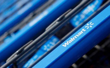 FILE PHOTO - Shopping carts are seen outside a new Wal-Mart Express store in Chicago