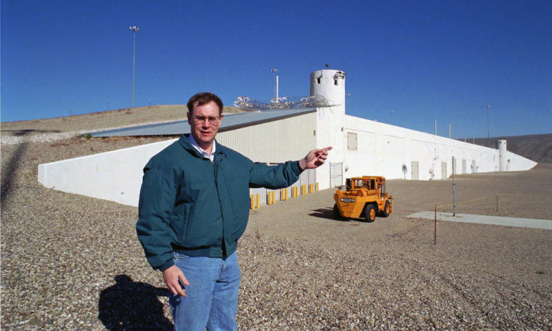 FILE - In this Feb. 18, 1997 file photo, then John McGrail, director of the Department of Energy stockpile stewardship program, talks about the $100 million Device Assembly Facility behind him at the Nevada Test Site in Mercury, Nev. Nevada's U.S. senators and Energy Secretary Rick Perry are set to tour the site north of Las Vegas where the federal government is handling weapons-grade plutonium shipped from South Carolina. A federal appeals court has ruled against Nevada in a legal battle over the U.S. government's secret shipment of weapons-grade plutonium to a site near Las Vegas. A three-judge panel of the 9th U.S. Circuit Court of Appeals on Tuesday, Aug. 13, 2019, denied the state's appeal after a judge refused to block any future shipments to Nevada. The court in San Francisco says the matter is moot because the Energy Department already sent the radioactive material and has promised that no more will be hauled there. (AP Photo/Lennox McLendon, File)