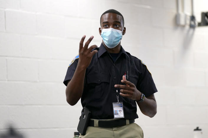 In this Sept. 9, 2020, photo Ockeive Farquharson, a cadet in the Baltimore Police Academy, reacts to a video presentation during a class focusing on procedural justicein Baltimore. (AP Photo/Julio Cortez)