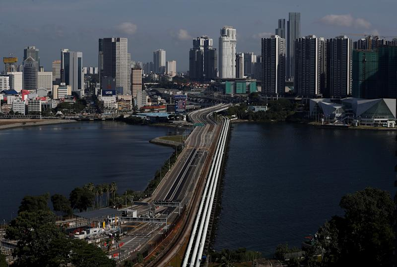 A view of the empty Woodlands Causeway between Singapore and Malaysia after Malaysia imposed a lockdown on travel due to the coronavirus disease (COVID-19) outbreak March 18, 2020. REUTERS/Edgar Su