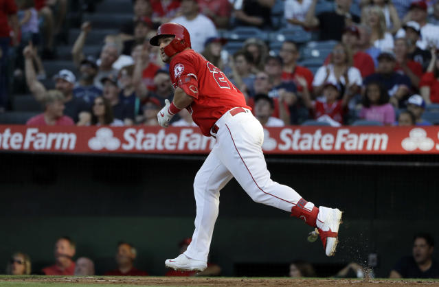 Los Angeles Angels' Mike Trout watches his two-run home run against the Seattle Mariners during the third inning of a baseball game Saturday, July 13, 2019, in Anaheim, Calif. (AP Photo/Marcio Jose Sanchez)