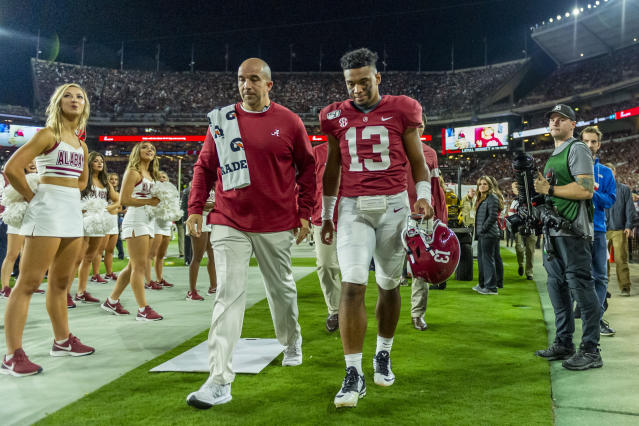 Alabama quarterback Tua Tagovailoa (13) walks off the field after getting hurt against Tennessee on Saturday. (AP)