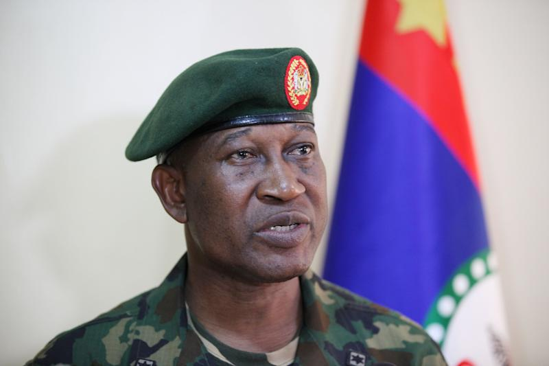 FILE- In this Thursday, May, 30 2013 file photo, Brig. Gen. Chris Olukolade, Nigeria's top military spokesman speaks during an interview in Abuja, Nigeria, The fate of 115 female students abducted by Islamic extremists was thrown into uncertainty Thursday, April 17, 2014 when their school principal denied the Nigerian military's report that almost all the pupils had been freed. The principal directly contradicted Maj. Gen. Chris Olukolade, the Defense Ministry spokesman. (AP Photo/Jon Gambrell, File)