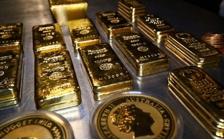 FILE PHOTO: Gold bars and coins at the Pro Aurum gold house in Munich