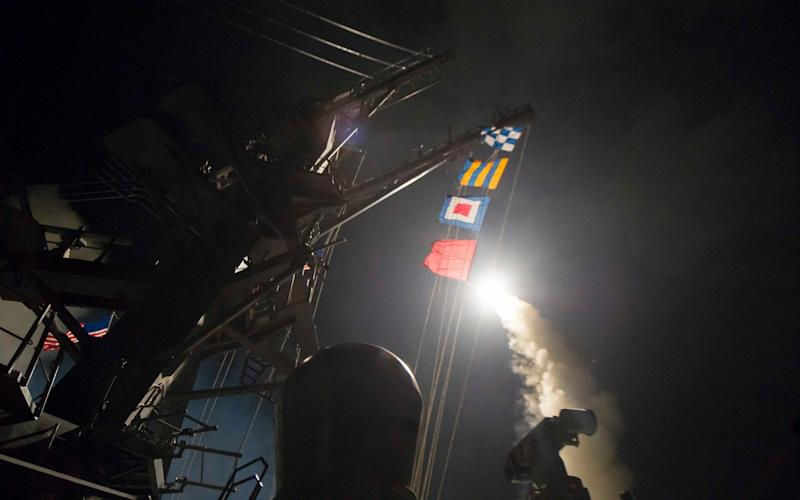 USS Ross fires a tomahawk land attack missile  - Credit: ROBERT S. PRICE/AFP/Getty