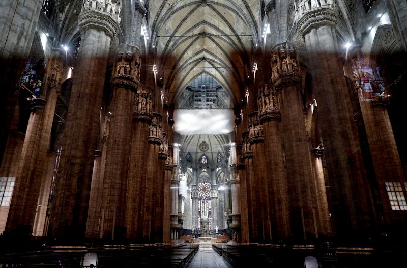 Image: Milan's Duomo sits empty after Italy's bishops cancelled masses because of the country's coronavirus outbreak on March 5, 2020. (Guglielmo Mangiapane / Reuters)