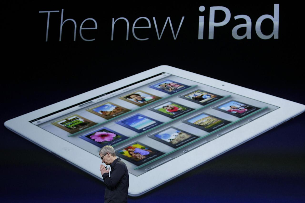Apple CEO Tim Cook clasp his hands during an new iPad announcement during an Apple event in San Francisco, Wednesday, March 7, 2012. The new iPad features a sharper screen and a faster processor. Apple says the new display will be even sharper than the high-definition television set in the living room. (AP Photo/Paul Sakuma)