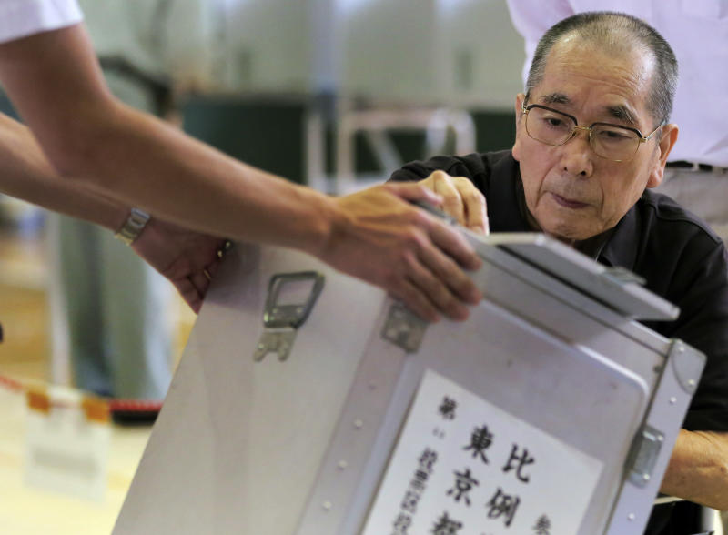 A man casts his vote in Japan's upper house parliamentary elections at a polling station in Tokyo, Sunday, July 21, 2013. (AP Photo/Itsuo Inouye)
