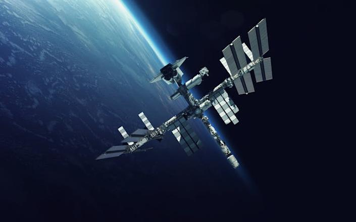"""<span class=""""caption"""">The International Space Station floats in orbit around Earth. Could a similar structure be designed to house a space junk recycling facility?</span> <span class=""""attribution""""><a class=""""link rapid-noclick-resp"""" href=""""https://www.shutterstock.com/image-photo/international-space-station-over-planet-earth-551379514?src=ieXB3LBWXxKYgWqRD_uQLA-1-0&studio=1"""" rel=""""nofollow noopener"""" target=""""_blank"""" data-ylk=""""slk:Vadim Sadovski/Shutterstock"""">Vadim Sadovski/Shutterstock</a></span>"""