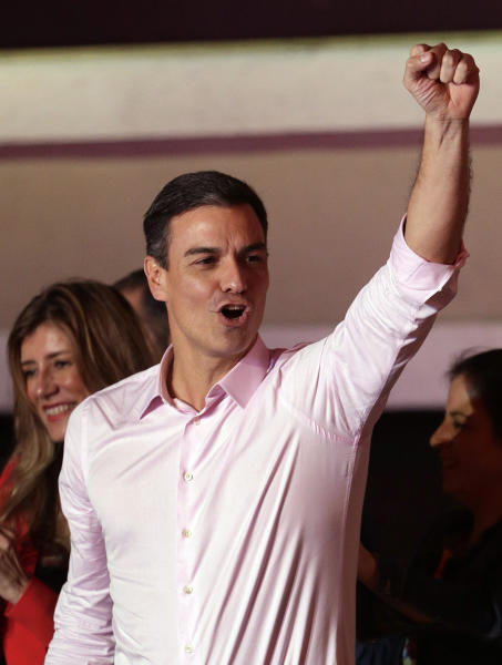 Spanish Prime Minister and Socialist Party candidate Pedro Sanchez gestures to supporters gathered at the party headquarters waiting for results of the general election in Madrid, Sunday, April 28, 2019. Spain's governing Socialists won the country's national election Sunday but will need the backing of smaller parties to stay in power, while a far-right party rode a groundswell of support to enter the lower house of parliament for the first time in four decades, provisional results showed. (AP Photo/Andrea Comas)