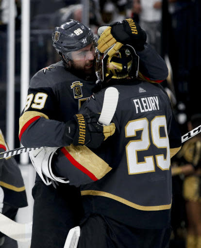 Vegas Golden Knights right wing Alex Tuch, left, celebrates the team's 3-2 win over the Winnipeg Jets with Marc-Andre Fleury after Game 4 of the NHL hockey Western Conference finals Friday, May 18, 2018, in Las Vegas.(AP Photo/John Locher)