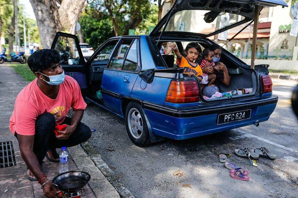 S. Ganesh, his wife Parameswari, and three young children have had to live out of his car after their house on Carnarvon Street caught fire in April. — Pictures by Sayuti Zainudin