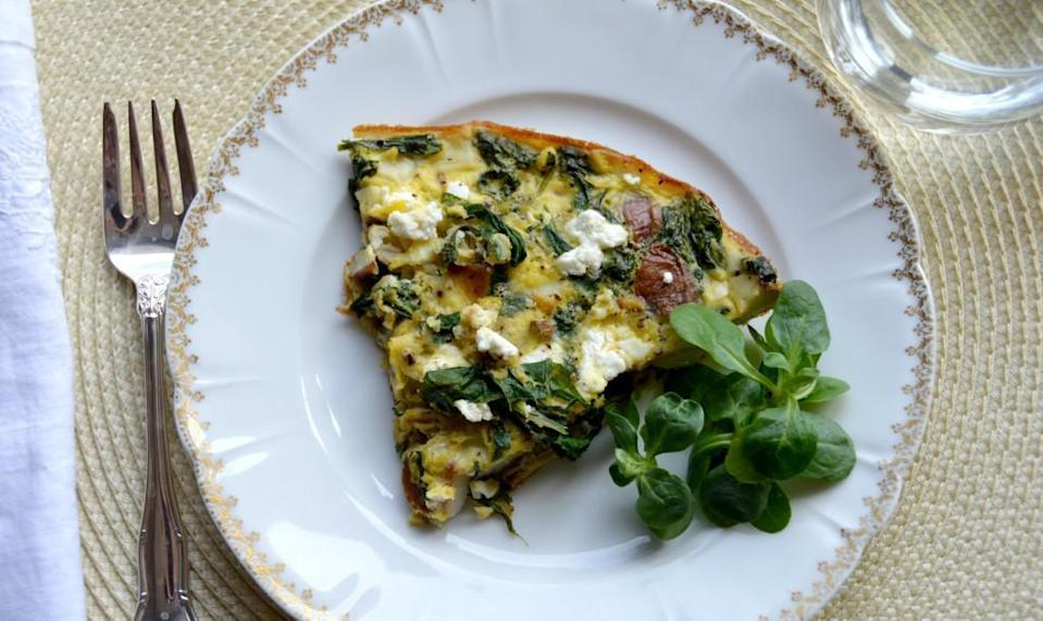 """<p>If you have eggs in the fridge, an omelet is the usual suspect. But if you also happen to have a few vegetables lying around, maybe some cheese and leftover potatoes from dinner, go ahead and make yourself a delicious frittata. This recipe calls for turnip greens, but you can use spinach, kale, collard greens or any leafy vegetable you like. Like any frittata, this recipe can be made entirely ahead of time and reheated. </p> <p><br><a href=""""https://www.thedailymeal.com/best-recipes/turnip-greens-potato-frittata-brunch?referrer=yahoo&category=beauty_food&include_utm=1&utm_medium=referral&utm_source=yahoo&utm_campaign=feed"""" rel=""""nofollow noopener"""" target=""""_blank"""" data-ylk=""""slk:For the Turnip Greens and Potato Frittata recipe, click here"""" class=""""link rapid-noclick-resp"""">For the Turnip Greens and Potato Frittata recipe, click here</a>.</p>"""