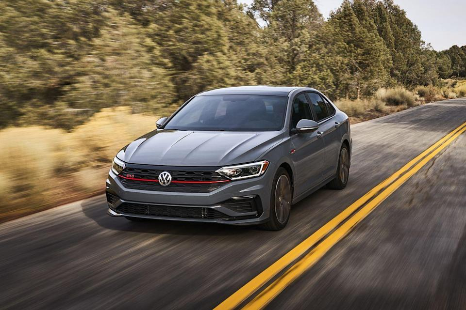"<p>The <a href=""https://www.caranddriver.com/volkswagen/jetta-gli"" rel=""nofollow noopener"" target=""_blank"" data-ylk=""slk:2021 Volkswagen Jetta GLI"" class=""link rapid-noclick-resp"">2021 Volkswagen Jetta GLI</a> has the same amazing driving attributes that make the <a href=""https://www.caranddriver.com/volkswagen/golf-gti-2021"" rel=""nofollow noopener"" target=""_blank"" data-ylk=""slk:Golf GTI"" class=""link rapid-noclick-resp"">Golf GTI</a> a smash hit. Although the hatchback has a nicer interior, it's actually the sedan that's more practical, thanks to its roomier back seat and bigger trunk. Both <a href=""https://www.caranddriver.com/volkswagen"" rel=""nofollow noopener"" target=""_blank"" data-ylk=""slk:VW's"" class=""link rapid-noclick-resp"">VW's</a> boast a potent 228-hp turbocharged four-cylinder that mates to either an engaging manual transmission or a quicker-shifting automatic. The sedan's aesthetic is more sedated than its hot-hatch sibling, but at least it sells at a discounted price, as the GLI costs thousands less than the GTI. Still, these two Vee-Dubs are equally entertaining whether they're looping racetracks or racing down back roads—which made it an easy choice for <a href=""https://www.caranddriver.com/features/a34690878/10best-2021-vw-golf-gti-jetta-gli/"" rel=""nofollow noopener"" target=""_blank"" data-ylk=""slk:our 2021 10Best list"" class=""link rapid-noclick-resp"">our 2021 10Best list</a>. Simply put, the 2021 Jetta GLI is compact-sedan greatness.</p><p><a class=""link rapid-noclick-resp"" href=""https://www.caranddriver.com/volkswagen/jetta-gli"" rel=""nofollow noopener"" target=""_blank"" data-ylk=""slk:Review, Pricing, and Specs"">Review, Pricing, and Specs</a></p>"